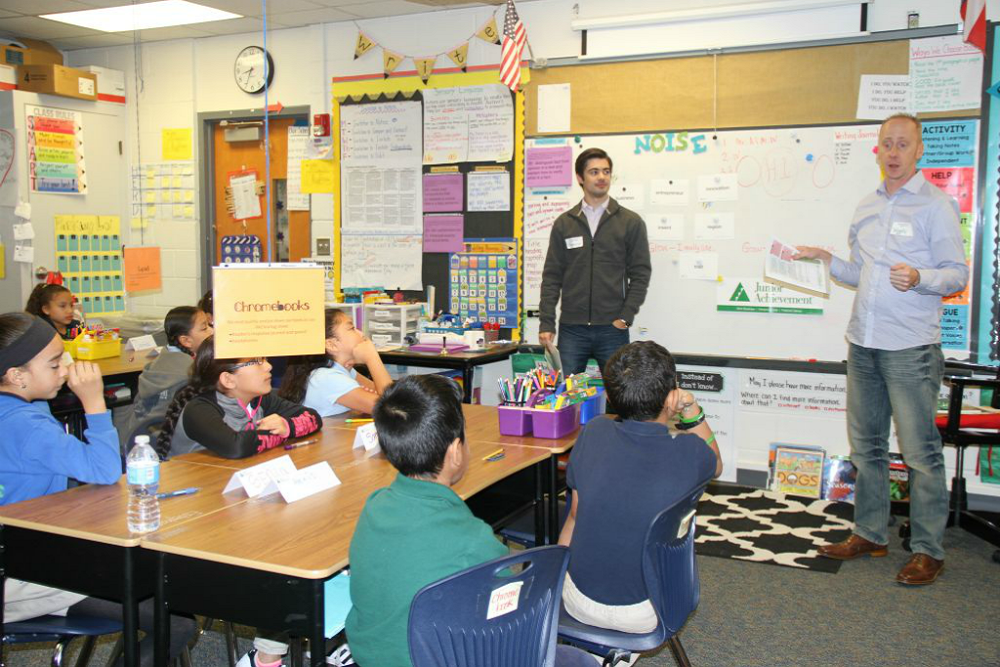 The volunteers came from different departments within the airline and worked with students from each grade.
