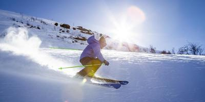 Skiing is a great way to enjoy the outdoors and burn lots of calories.