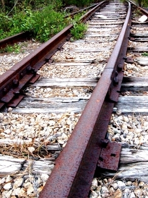 Large railroad tracks rusty pebbles