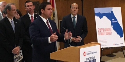 Republican Gov. Ron DeSantis, with U.S. Chamber Institute for Legal Reform COO Harold Kim to his left, during today's news conference at the Florida Capitol