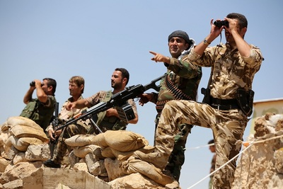 Kurdish Peshmerga fighters at the front line in Bashiqa, Iraq