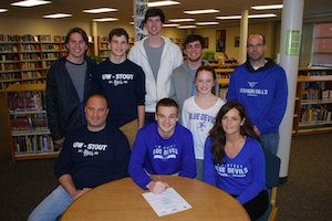 Sam Perlin, center, signs with the University of Wisconsin-Stout