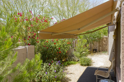 A retractable awning can provide plenty of shade from the hot summer sun on the patio or deck.
