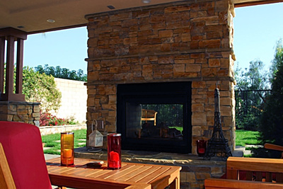Outdoor fireplaces provide a bit more control of sparks and flames than fire pits.