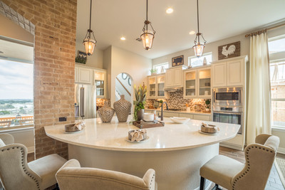 Elegant yet accessible, the kitchen boasts the perfect breakfast bar.