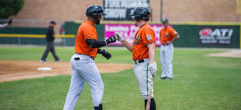 Two Joliet Slammers celebrate scoring a run during a recent game.