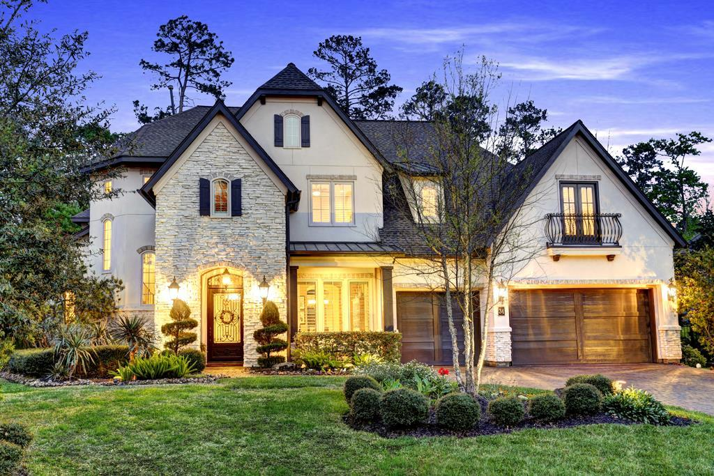 This stunning custom home in Sterling Ridge boasts excellent curb appeal.