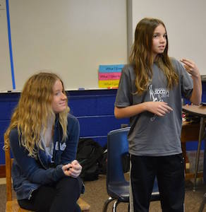 Stephanie Richey and Jadyn Adams prepare for the 2016 Illinois Fingerspelling Bee on April 21.