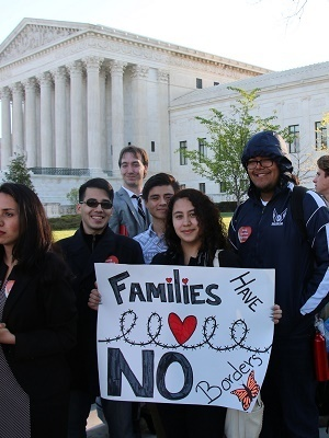 Pro-immigration reform advocates rally outside the U.S. Supreme Court in Washington, D.C. on April 18, 2016.