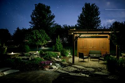 Outdoor lighting can make a backyard environment magical at night.