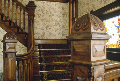 Archtiectural details like antique newel caps for staircases can be recreated with a little research and custom millwork.