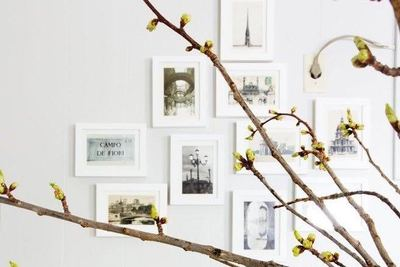 Postcards from trips are framed and displayed on the wall in a breakfast banquette.