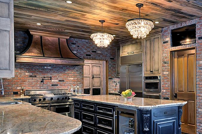 Custom-fabricated range hoods make a huge visual impact in a kitchen area.