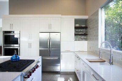 The new trends in kitchen decor include painted modern cabinets.