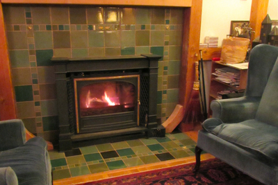 There is a wide range of options for finishing a fireplace with tile.