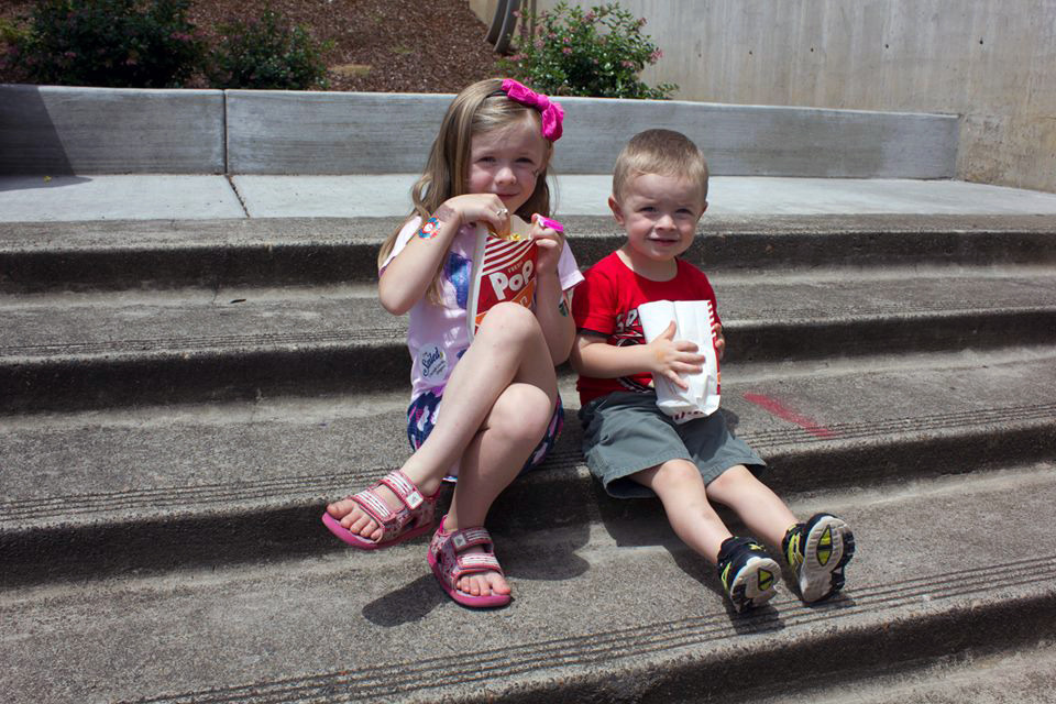 Children enjoy a summer day at the annual Strawberry Short Course Festival in Gresham