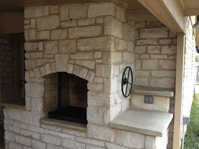 A stacked stone fireplace created by Texas Stone Masons in Austin.