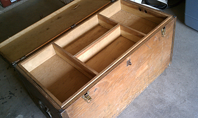 Using an antique storage locker as a coffee table increases storage options.