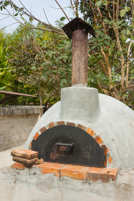 Outdoor pizza ovens are a welcome addition to a backyard.