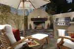 Outdoor fireplaces are a great option to warm your outdoor living space through the winter.