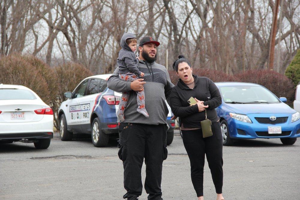 Benny Correa and Amanda Disley react to seeing their overhauled Escalade at Balise Collision Repair.