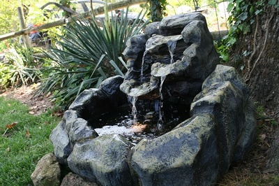 A disappearing fountain keeps a constantly recycling trickle flowing at all times.