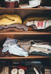 Try experimenting with different shelf levels to maximize the closet space you have.
