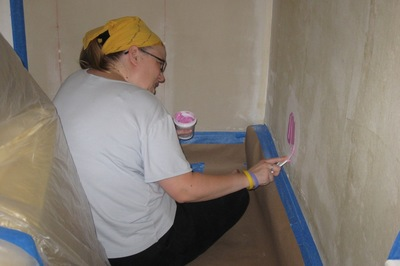 Often simple patching in walls can be done with spackling or painter's putty.