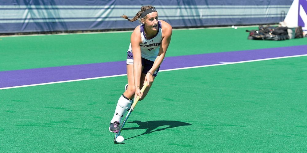 A member of the Northwestern field hockey team controls the ball during a game.