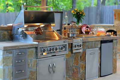Outdoor kitchens are becoming standard on upscale new homes.