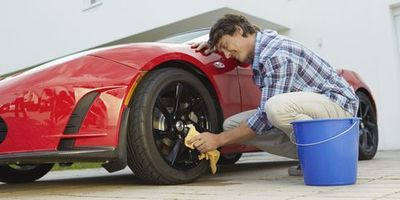Use a hose and a microfiber sponge soaked in soap to clean off the car exteriors.