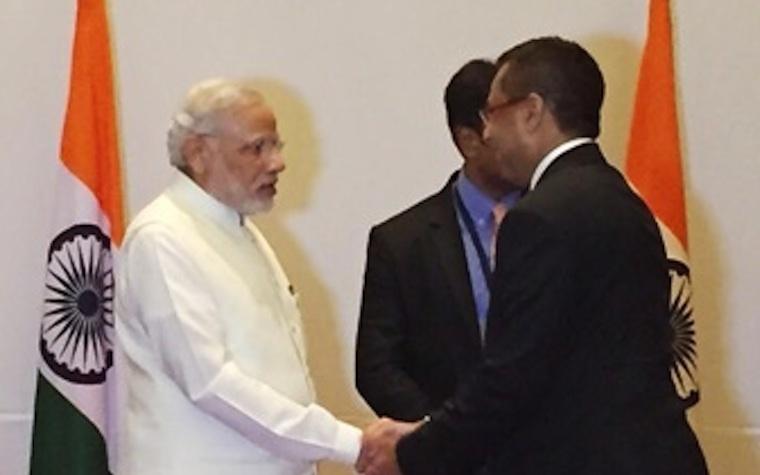 Indian Prime Minister Narendra Modi (left) meets KEF Holdings Chairman Faizal E. Kottikollon.