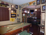 A man cave should have a focal point, such as a pool or a bar (or both).