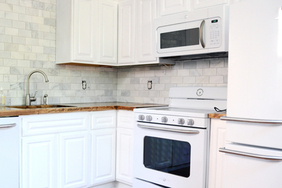 White kitchens are growing in popularity thanks to improvements in appliance finishes.