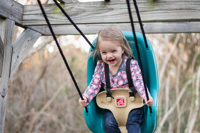 A child enjoying a backyard swing.