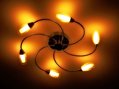 Lighting fixtures can add flair to the home -- just remember to be cautious when installing them.