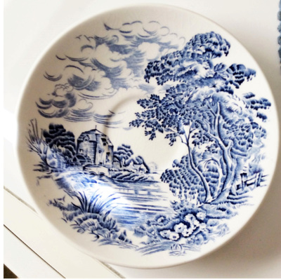 The print on this earthenware set is of the romantic English countryside.