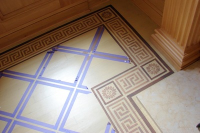 Floor stencils can liven up a simple concrete floor.