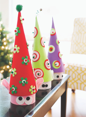 Turn inexpensive paper-mache boxes and cones into an eye-catching place to store wrapped holiday treats.