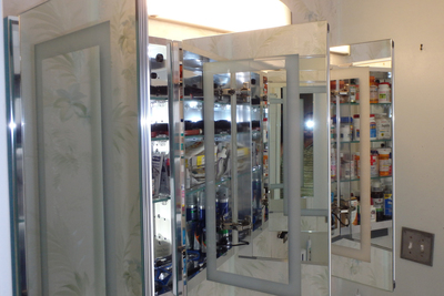 Replacing a simple mirror with a medicine cabinet creates more available storage.