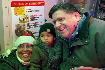 "Illinois Gov. J.B. Pritzker with a Chicago-area family last month. Pritzker's ""fair tax"" plan would cost the typical DuPage County family about $3,500, according to an Illinois Policy Institute report."