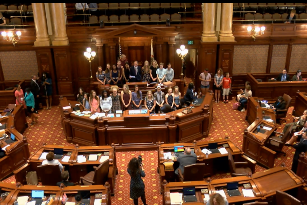 Sen. Chuck Weaver (R-Peoria) congratulating Lady Eagles for winning state championship during the May 29 House floor debate