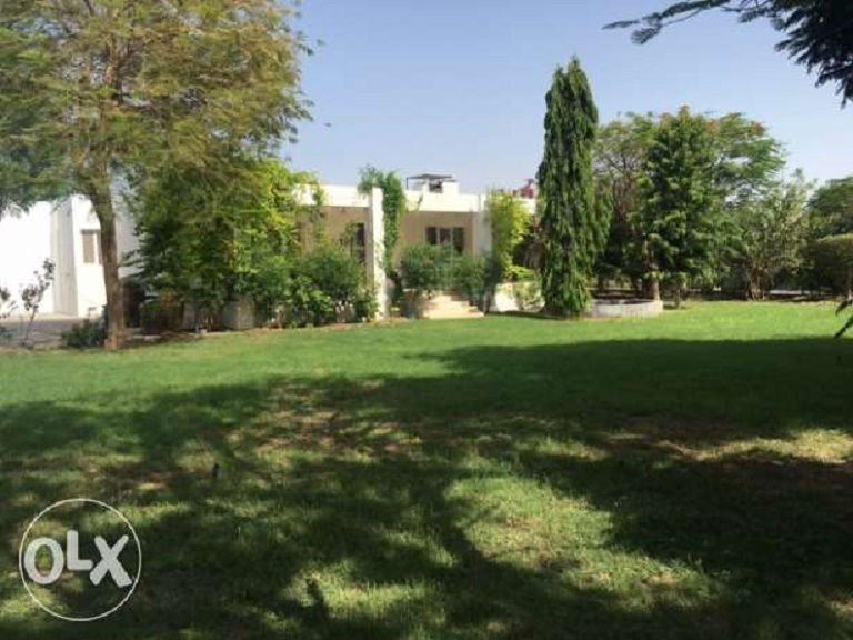 This farmhouse in Barka is beautifully landscaped.
