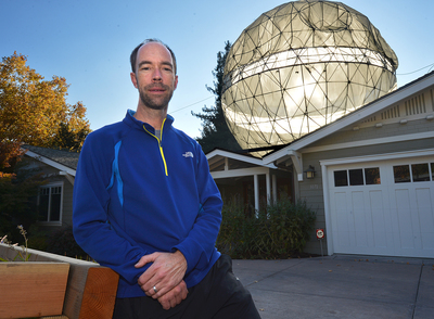 Colby Powell, of Lafayette, Calif., stands in his front yard with a 23-foot-high