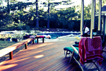 A wooden deck is a pleasing addition to the perfect summertime outdoor amenity.