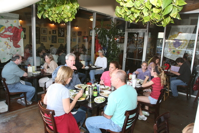 Patrons enjoy tasty Cajun dishes in the Cypress Grill's outdoor dining area.