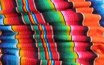 Tommye McClure Scanlin crafts   color-filled, handwoven tapestries.