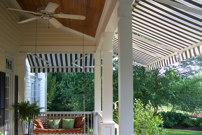 In dealing with a hot Texas afternoon, fabric awnings are a simple solution to making a porch a bit cooler.