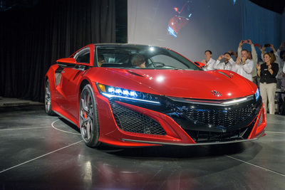 Rich Hendrick behind the wheel of the very first production NSX. He chose red and a number of carbon-fiber-trim upgrades as well as carbon-ceramic brakes.