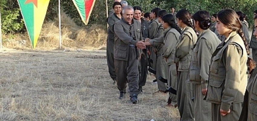 PKK female Guerilla fighters welcome Syrian Kurdish delegation from the YPG at a meeting in Kirkuk Aug. 2